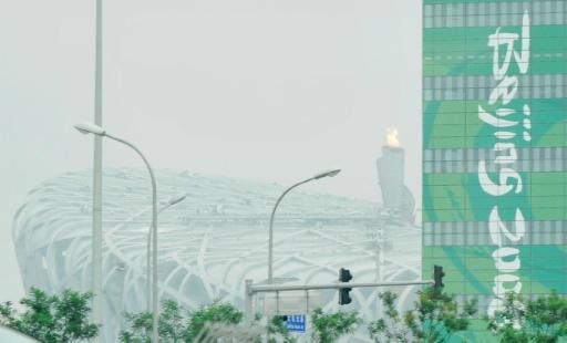 """Le Stade national de Pékin, surnommé le """"Nid d'oiseau"""", symbole de la démonstration de force de la Chine lors des jeux Olympiques qu'elle a accueillis à l'été 2008 © PHILIPPE HUGUEN AFP/Archives"""