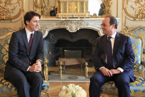 M. Hollande a félicité le nouveau Premier ministre canadien pour les progrès accomplis par son pays dans la lutte contre le réchauffement climatique © THIBAULT CAMUS POOL/AFP