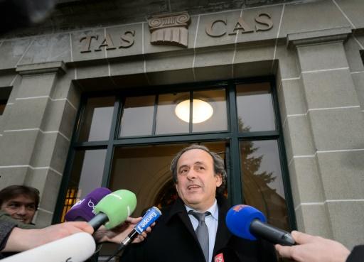 Michel Platini à la sortie le 8 décembre 2015 du Tribunal arbitral du sport (TAS) à Genève © FABRICE COFFRINI AFP