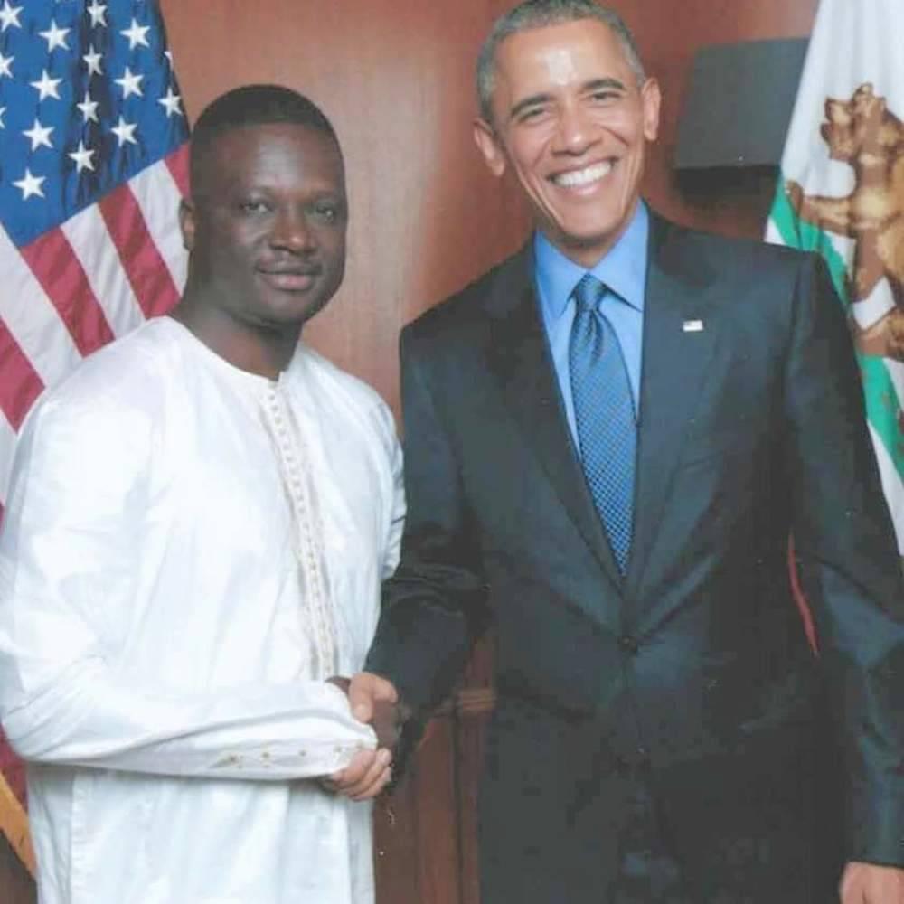 Thione Niang avec le président Barack Obama. Ici en 2012, alors qu'il est en campagne pour un second mandat,  renouvelant de fait sa confiance à Thione Niang. ©  DR/Facebook