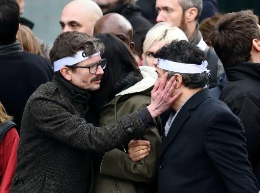 """Le dessinateur Luz et l'urgentiste Patrice Pelloux lors de la """"marche républicaine"""" du 11 janvier 2015 à Paris © ERIC FEFERBERG AFP/Archives"""
