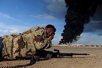 Un combattant rebelle en Libye, en mars 2011. ©ROBERTO SCHMIDT