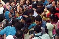 Les chrétiens enterrent leurs morts au lendemain d'une attaque-suicide qui a fait 72 victimes dans un parc de Lahore. ©ARIF ALI