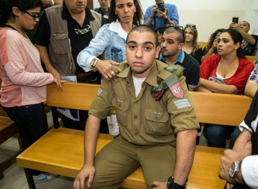 Le soldat israélien Elor Azaria, filmé en train d'achever un assaillant palestinien blessé en Cisjordanie, inculpé pour homicide devant la justice militaire à Tel Aviv le 18 avril 2016 © JACK GUEZ AFP