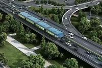"""Les ingenieurs chinois travaillent sur un modele innovant de """"bus"""" sur rails, capable de passer au-dessus des files de voitures."""