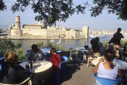 Marseille, le fort Saint-Jean et l'entree du Vieux Port vus de la buvette du Chalet dans le jardin du Pharo. ©Nicolas Thibaut