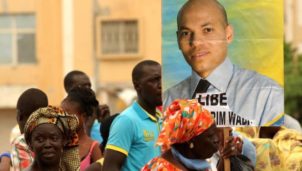 Manifestation en soutien à Karim Wade, à Dakar, le 8 octobre 2013. ©  AFP/Seyllou Diallo