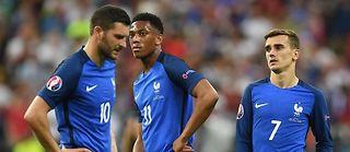 La tristesse de Gignac, Martial et Griezmann à l'issue de la défaite face au Portugal après prolongation. ©PATRIK STOLLARZ