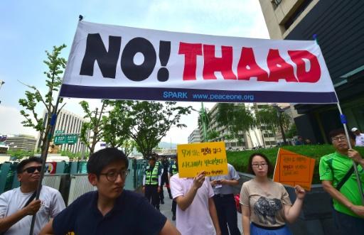 Manifestants sud-coréens protestant contre le système antimissile américain THAAD, le 11 juillet 2016 à Séoul © JUNG YEON-JE AFP