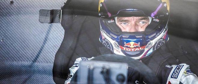 Le regard magnétique de Loeb au moment du départ de Pikes Peak sur une terrifiante 208 pas si éloignée des voitures de rallyes groupe B
