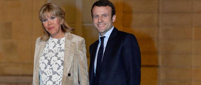 Pour convaincre, Emmanuel Macron – ici avec sa femme –doit se distinguer des professionnels de la politique, qui raisonnent trop souvent en termes d'image, de jeux d'alliance et de carrière.