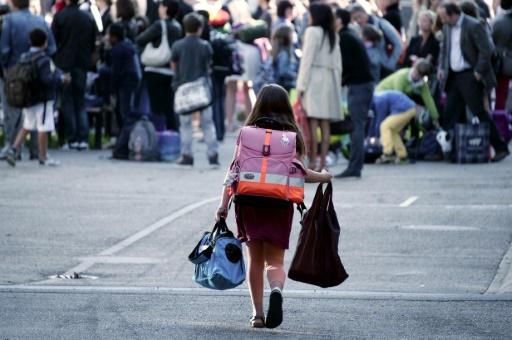 Après avoir marché, les enfants hyperactifs ou agités arrivent à l'école plus tranquilles car ils ont libéré leur adrénaline © FREDERICK FLORIN AFP/Archives