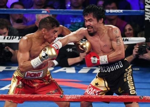 Le Philippin Manny Pacquiao (d) face à l'Américain Jessie Vargas pour le titre WBO des welters, le 5 novembre 2016 à Las Vegas © Ethan Miller Getty/AFP