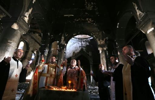 Une messe est célébrée dans l'église de l'Immaculée Conception le 30 octobre 2016 à Qaraqosh, reprise au groupe Etat islamique © SAFIN HAMED AFP/Archives