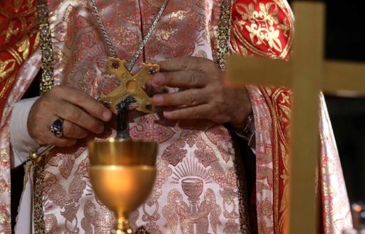 L'archevêque syro-catholique de Mossoul Yohanna Petros Mouche célèbre la messe dans l'église de l'Immaculée Conception le 30 octobre 2016 à Qaraqosh, à 30 kms de Mossoul © SAFIN HAMED AFP/Archives
