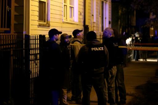 Des policiers enquêtent sur les lieux d'un crime, le 16 novembre 2016 à Chicago © Joshua Lott AFP