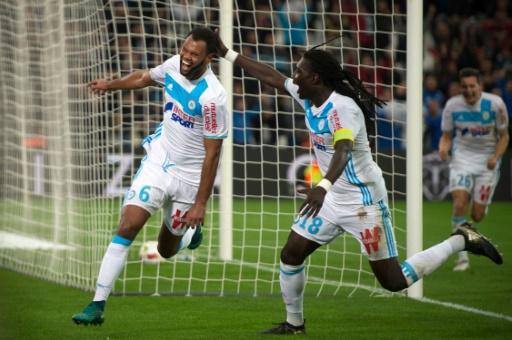 La joie de Rolando (g) après son but pour l'OM face à Caen, le 20 novembre 2016 à Marseille © BERTRAND LANGLOIS AFP