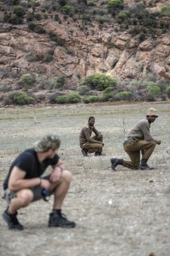 Une équipe de rangers et d'anciens militaires lors d'une opération de lutte contre le braconnage le 10 novembre 2016 dans la réserve de Kuduland à Musina en Afrique du Sud © MUJAHID SAFODIEN AFP