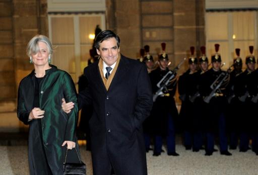 François Fillon et son épouse Pénélope à leur arrivée à l'Elysée le 2 mars 2011 à Paris © LIONEL BONAVENTURE AFP