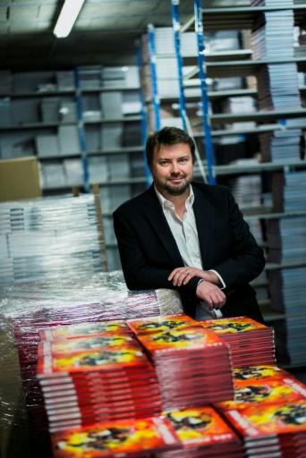 Olivier Sulpice, le fondateur de la maison d'édition bourguignonne Bamboo, dans ses locaux novembre 2016 à Charnay-les-Macon © JEFF PACHOUD AFP