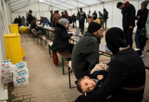 Des réfugiés patientent lors d'un centre de pré-enregistrement à Berlin, le 15 octobre © ODD ANDERSEN AFP/Archives