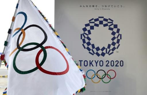 Tokyo accueillera les Jeux de 2020, ici l'arrivée officielle du drapeau olympique à l'aéroport de Haneda de la capitale nippone, le 24 août 2016 © KAZUHIRO NOGI AFP/Archives