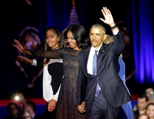 Barack Obama, son épouse Michèle et sa fille Malia, lors de ses adieux le 10 janvier 2017 à Chicago © Joshua LOTT AFP/Archives