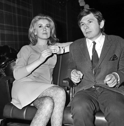 """Catherine Deneuve et Roman Polanski lors de la projection du film """"Répulsion"""", le 7 janvier 1966 dans une salle de cinéma à Paris ©  AFP/Archives"""