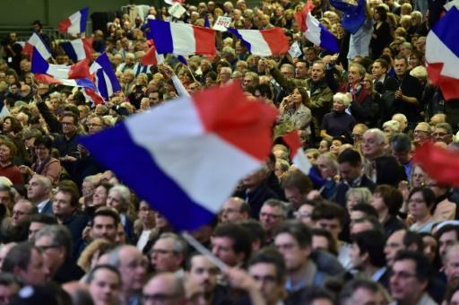 Des sympathisants de François Fillon lors d'un meeting, le 29 janvier 2017 à Paris © CHRISTOPHE ARCHAMBAULT AFP