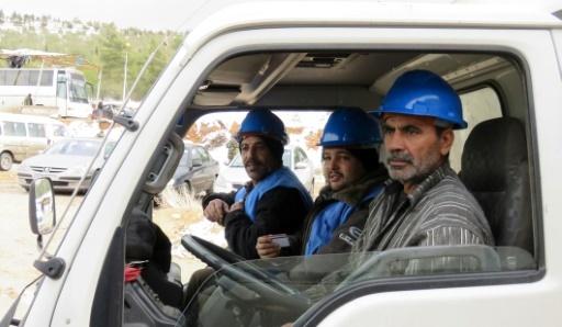 Arrivée de techniciens syriens dans la dans la station de pompage le 28 janvier 2017 à Aïn al-Fijé © STRINGER AFP