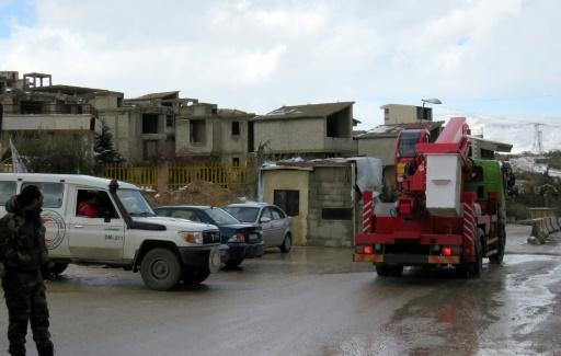 Des équipes de maintenance à leur arrivée le 28 janvier 2017 à Aïn al-Fijé pour intervenir sur la station de pompage  © STRINGER AFP