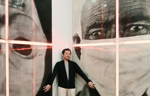 L'artiste chinois Gao Bo à la Maison européenne de la photographie à Paris, dans le cadre des préparatifs pour son exposition, le 6 février 2017   © ALAIN JOCARD AFP