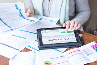 Senior woman consulting documentation about retirement.  VOISIN/PHANIE ©VOISIN