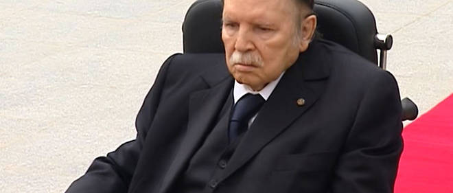 "A video grab from footage broadcast by Algeria's ""Canal Algerie"" on July 5, 2016 shows wheelchair-bound Algerian President Abdelaziz Bouteflika visiting El-Alia cemetery where independence fighters are buried in an eastern Algiers suburb.Bouteflika made his first public appearance in a year to mark the 57th anniversary of Algeria's independence from France. The ailing 79-year-old, who suffered a stroke in 2013 that has impeded his mobility and speech, was shown on state television visiting the cemetery. / AFP PHOTO / canal / -"