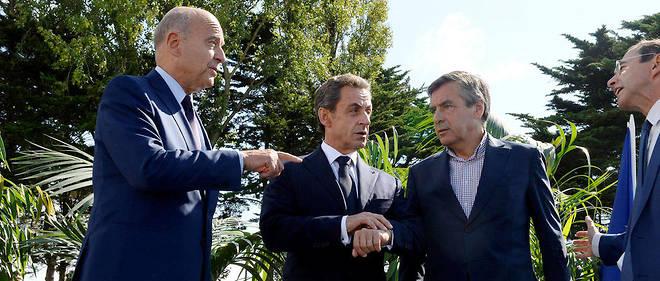 Alain Juppé, Nicolas Sarkozy et François Fillon à l'université d'été des Republicains à la Baule, en septembre 2015.