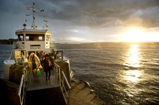 Des touristes reviennent de l'île de Hovedoya dans le fjord d'Oslo, le 24 août 2012 © ODD ANDERSEN AFP/Archives