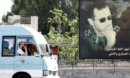 Le portrait du président syrien Bachar al-Assad dans une rue de Damas, le 7 avril 2017 © Louai Beshara AFP