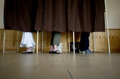 """Lors du scrutin présidentiel, """"on ne demande plus à l'électorat ce qu'il veut, on le force à des calculs basés sur des sondages"""", dénonce un chercheur © JEFF PACHOUD AFP/Archives"""