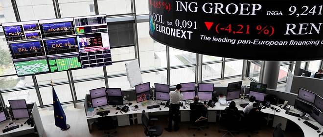 People work as screens display news and trading rates at the Euronext Stock Exchange services in Paris' financial district of La Defense on June 24, 2016 as Britain votes to leave the European Union, fuelling a wave of global uncertainty. / AFP PHOTO / Thomas SAMSON / The erroneous mention[s] appearing in the metadata of this photo by Thomas SAMSON has been modified in AFP systems in the following manner: [as Britain votes to leave the European Union, fuelling a wave of global uncertainty.] instead of [as Paris stocks surged in early trading today, with the key CAC-40 index gaining over three percent after polls suggested the Remain camp was ahead in the upcoming British referendum on EU membership. ]. Please immediately remove the erroneous mention[s] from all your online services and delete it (them) from your servers. If you have been authorized by AFP to distribute it (them) to third parties, please ensure that the same actions are carried out by them. Failure to promptly comply with these instructions will entail liability on your part for any continued or post notification usage. Therefore we thank you very much for all your attention and prompt action. We are sorry for the inconvenience this notification may cause and remain at your disposal for any further information you may require.