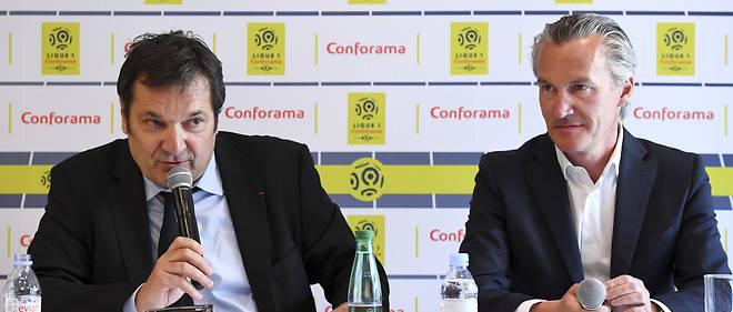 Didier Quillot, président de la LFP (à gauche), et Antoine Brieu, PDG de Conforama, annoncent la signature d'un contrat de «naming» pour la Ligue 1.