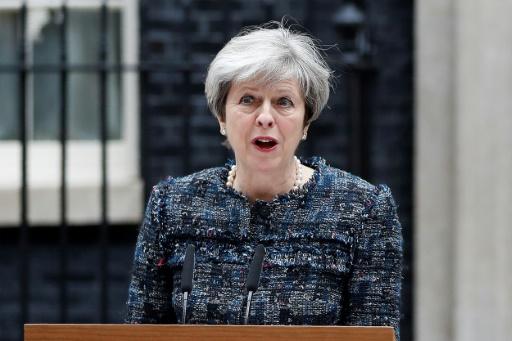 La Première ministre britannique Theresa May fait une déclaration devant le 10 Downing Street, le 3 mai 2017 à Londres © Adrian DENNIS AFP