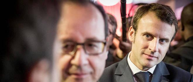 François Hollande, président de la République, et Emmanuel Macron, ministre de l'Économie, de l'Industrie et du Numérique, au Mondial de l'auto, porte de Versailles à Paris, vendredi 3 octobre 2014.