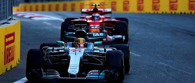 Le mano a mano entre Vettel au second plan sur la Ferrari et Hamilton (Mercedes) au premier plan rappelle les grandes rivalités du sport automobile