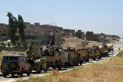 Des forces gouvernementales irakiennes sur une route conduisant à la ville de Tal Afar le 9 juin 2017 © MOHAMED EL-SHAHED AFP/Archives
