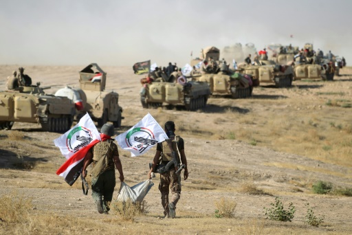 Des milices loyalistes marchent sur Tal Afar, en Irak, le 22 août 2017 © AHMAD AL-RUBAYE AFP