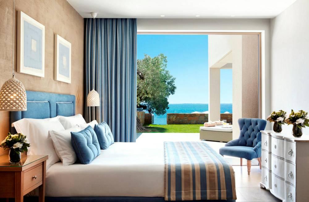 DeLuxe BedroomBungalow suite front de mer Olivia © Ikos ikos