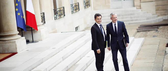 Au palais de l'Élysée, avant le premier conseil des ministres de la présidence Macron, Gérald Darmanin, ministre de l'Action et des Comptes publics, et Bruno Le Maire, ministre de l'Économie.