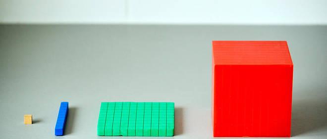 Dans la méthode de Singapour, la résolution de problèmes, très ritualisée, se fait avec des outils concrets, comme des cubes, des Legos, des barres en plastique...
