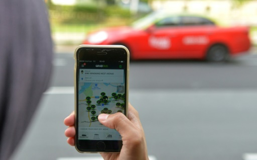 Selon Uber, les chauffeurs utilisant l'application du groupe au Royaume-Uni ont touche en moyenne, après les frais de service, 15 livres par heure © MOHD FYROL AFP/Archives