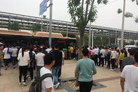Des travailleurs chinois se rendent chez Foxconn. Image d'illustration. ©Stringer